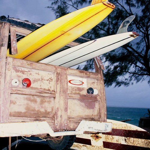 Noosa Woody with surf boards by the beach