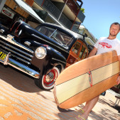 Noosa Woody with surf board